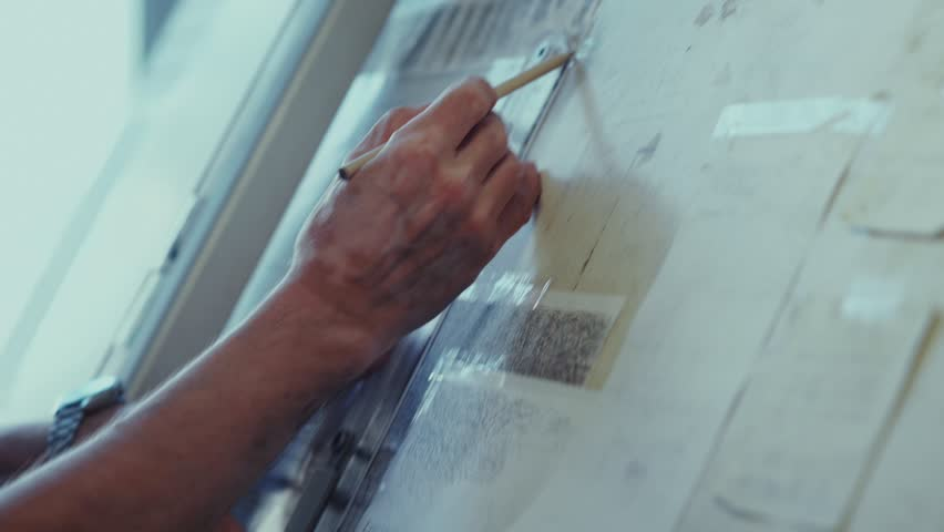 Drawing. Architect applies to line drawing and holding a pencil line. Architect at work. Drawing of the house. The architect draws using the easel. Workplace of architect. Bureau of Architecture.