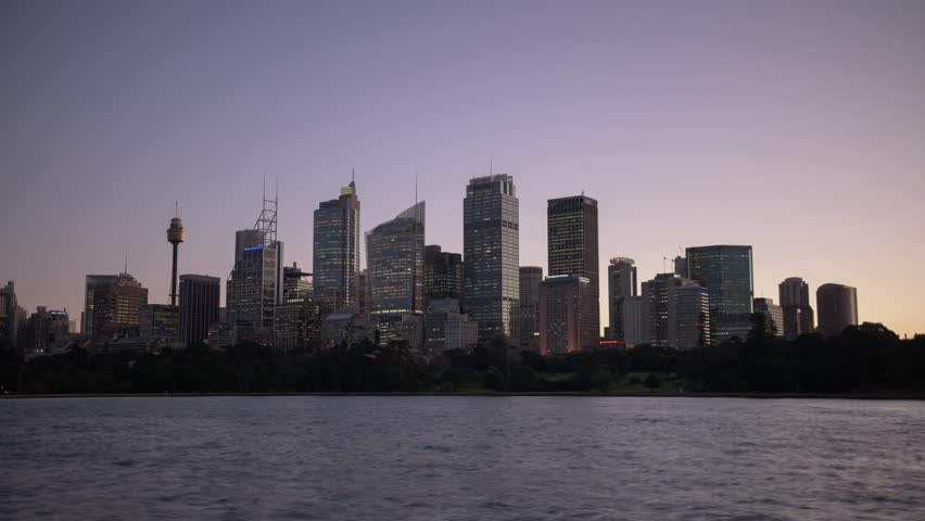 SYDNEY, AUSTRALIA - JULY 2016: Dusk time lapse of the Sydney City skyline in the fading light of dusk. | Shutterstock HD Video #20115475