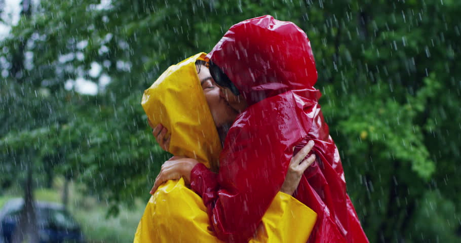 two teenagers or adults are kissing in the rain like lovers. Happy couple of life and nature around. concept of nature and happy life. Adventure, purity.