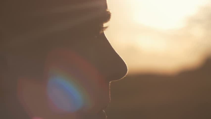 Close-up of man's eyes looking at the sun. Interested man looking for new opportunities as he thinks about the future. | Shutterstock HD Video #20127403