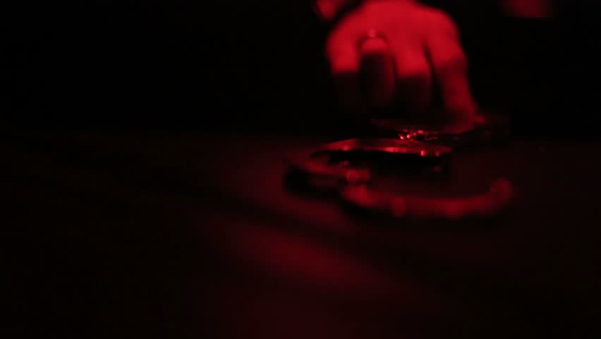 Man's hand taking handcuffs. Skary but erotic video