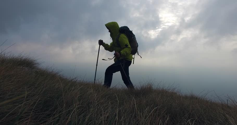 Walking uphill in bad stormy weather | Shutterstock HD Video #20174803