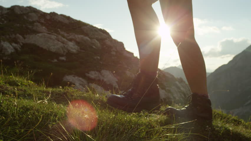 SLOW MOTION, CLOSE UP: Detail of vintage leather mountaineering boots and unrecognizable adventurous female hiker climbing mountain peak, hiking uphill on beautiful sunny summer day in European Alps #20183809