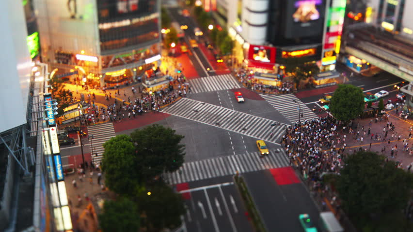 Thousands of people walk across the famous Shibuya Crossing in Tokyo Japan #20188564