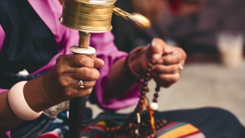 Buddhist prayer wheels, the ceremony at the temple. Woman pilgrim twisting prayer wheels. Closeup. Boudhanath, Kathmandu, Nepal. | Shutterstock HD Video #20217526