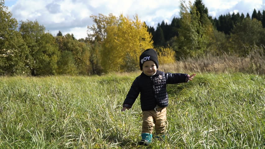 Little boy walks in the park in autumn day.Little boy running on the countryside road.Kid in the park Slow motion. | Shutterstock HD Video #20225641