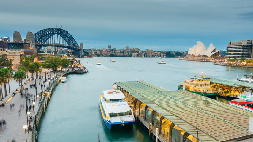 Sydney, Australia - June 26, 2016: 4k hyperlapse video of ferries and people visiting Circular Quay in Sydney CBD, with view of Harbour Bridge and Opera House