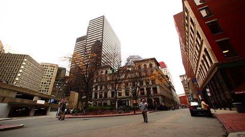 BOSTON - CIRCA 2011: Unidentified pedestrians walk by.