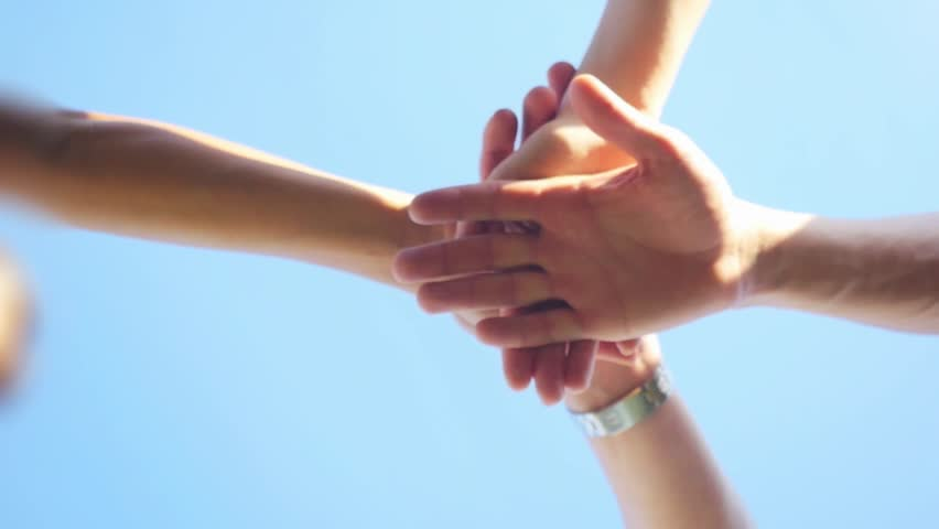 Successful team: many hands holding together on sky background in slowmotion. 1920x1080 #20240953