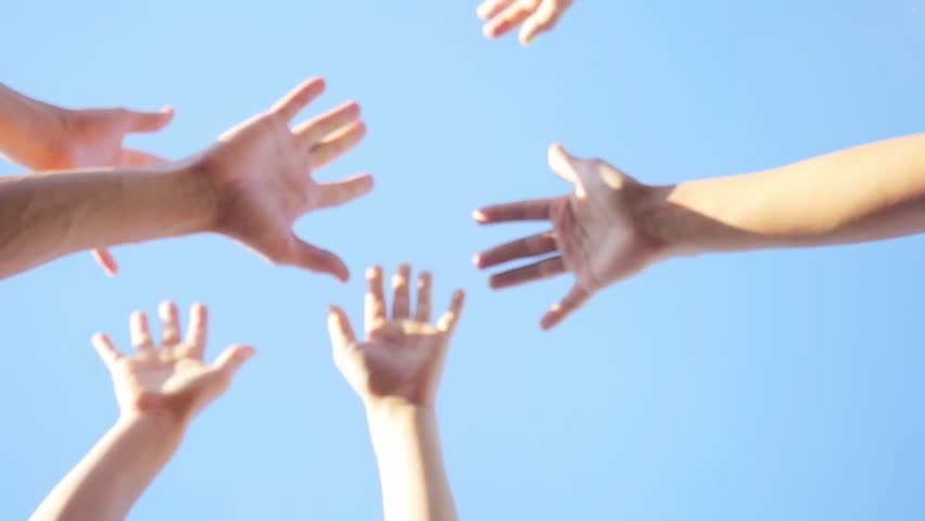 Successful team: many hands holding together on sky background in slowmotion. 1920x1080 #20240959