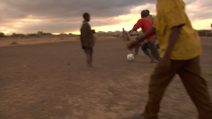 KENYA - CIRCA 2006: Unidentified group of kids play soccer circa 2006 in Kenya.