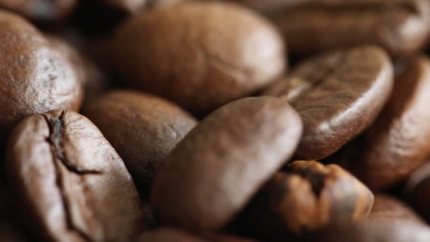Rotating roasted coffee beans background concept interesting | Shutterstock HD Video #20251459