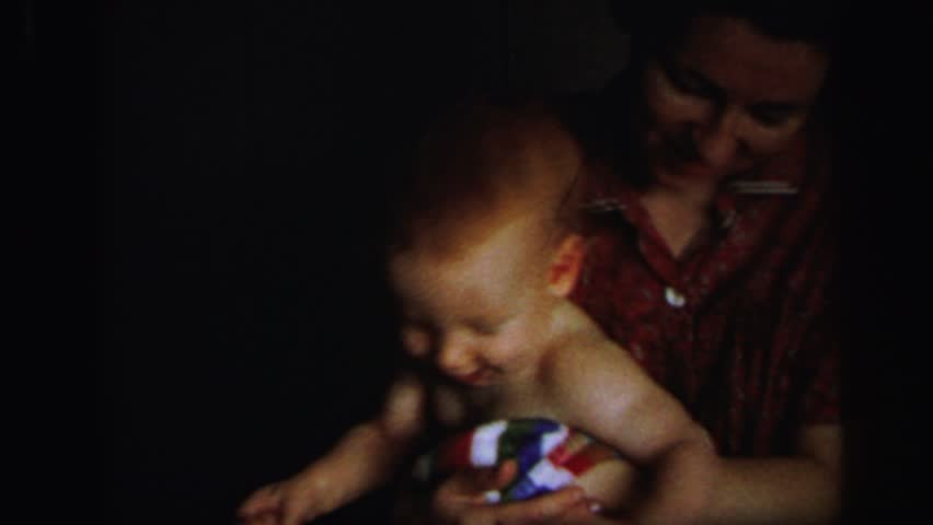 LYNBROOK, NEW YORK 1972: cute redhead baby boy playing mother #20258419