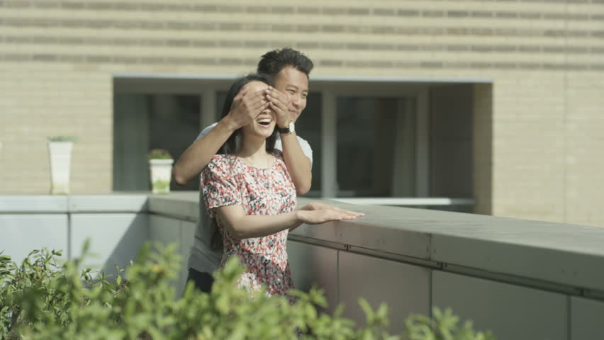 4K Happy romantic couple moving in to new apartment, young man surprises his partner by showing her the view. Shot on RED Epic. | Shutterstock HD Video #20278918