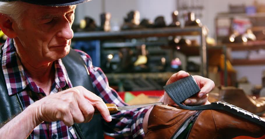Shoemaker repairing a shoe in workshop 4k | Shutterstock HD Video #20306905