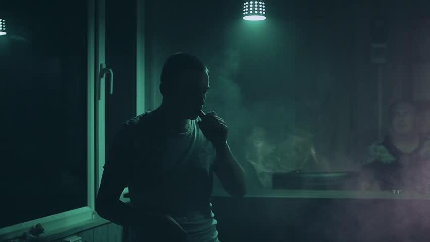 Man vaping in vape shop | Shutterstock HD Video #20314627