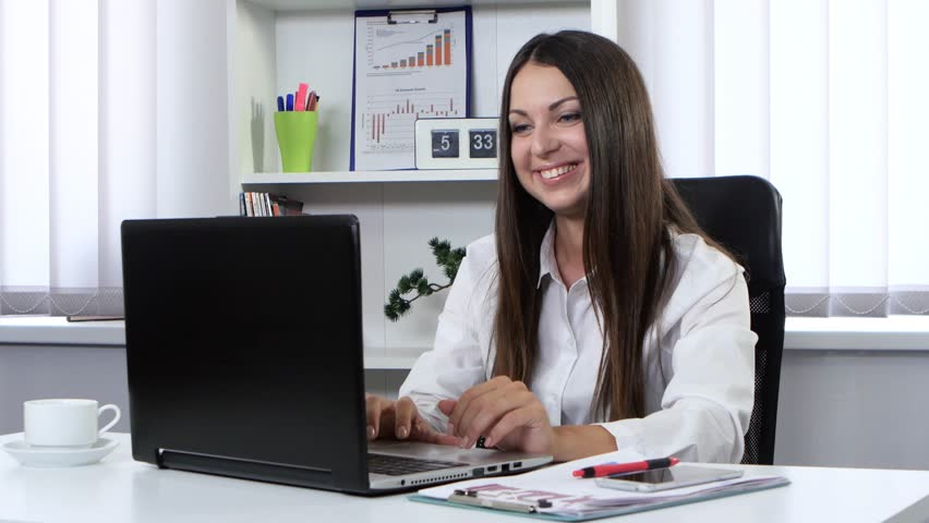 Smiling black woman waving talking on webcam stock photo