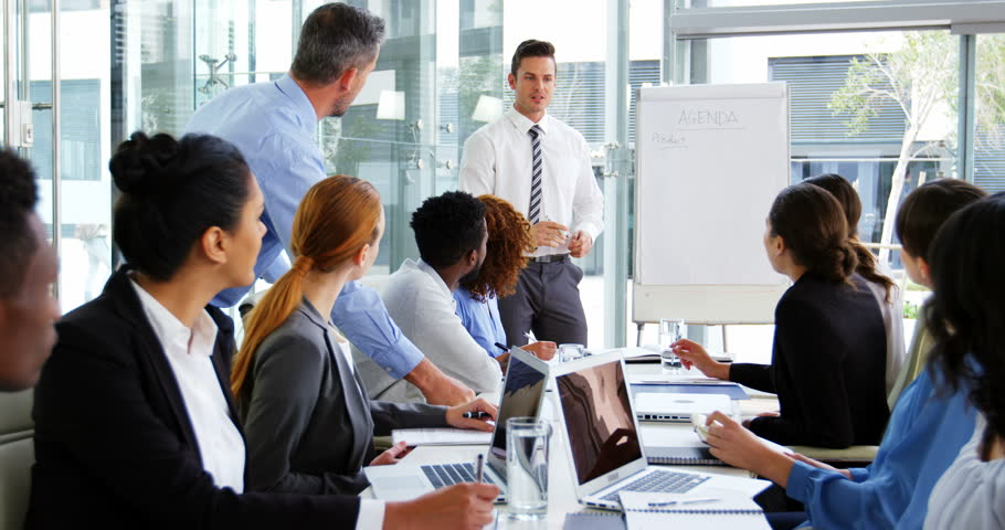 Businessman leading a meeting in conference room at office 4k #20332378