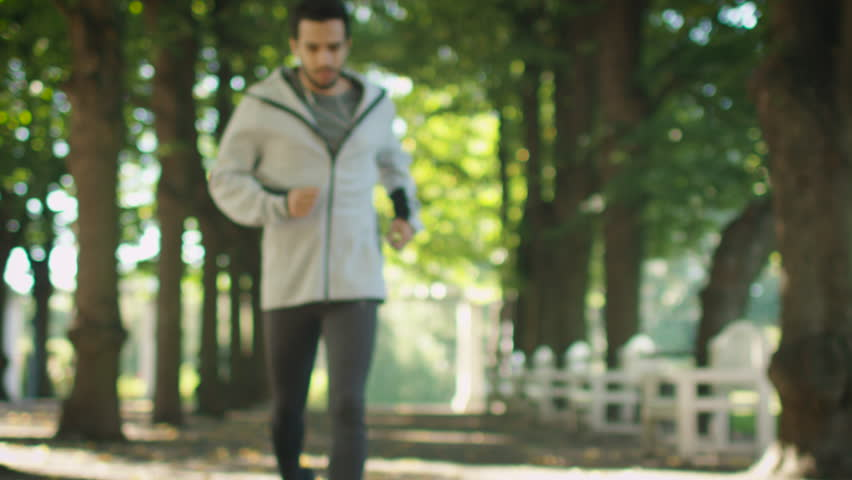Tired Male Jogger Stopped to Catch his Breath During Morning Run. Slow Motion. Shot on Cinema Camera in 4K (UHD).