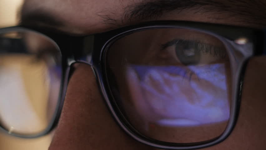 Man watching erotic content on internet reflection on glasses | Shutterstock HD Video #20334976