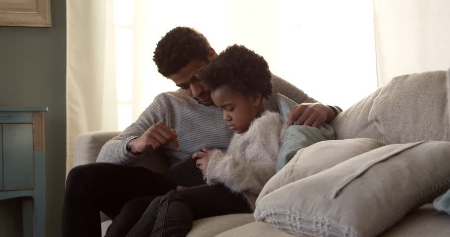 Father And Daughter On Sofa With Digital Tablet Shot On R3D #20341465
