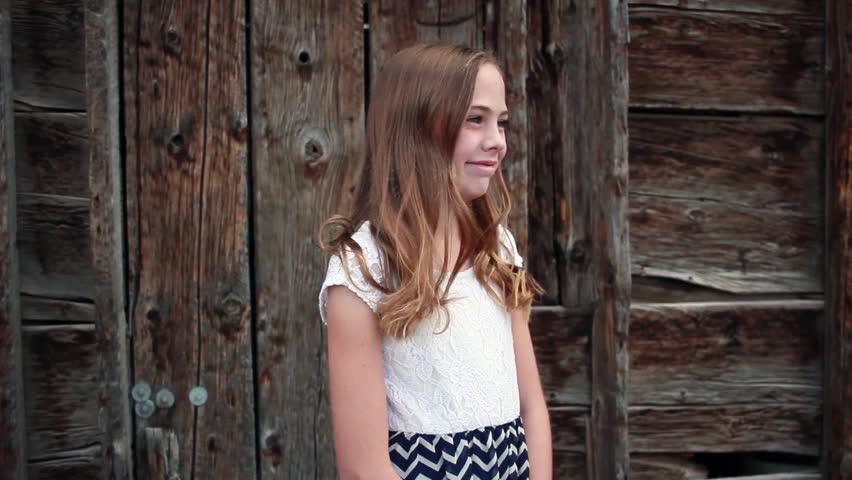 A Beautiful Tween Girl Smiles Stock Footage Video 100 Royalty Free 20345500 Shutterstock