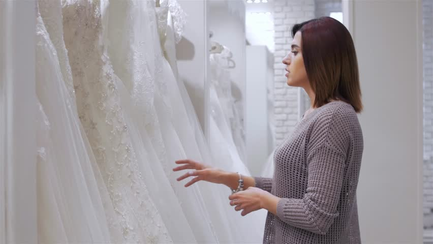 Two young beautiful brides trying her dress in shop. Wedding concept.   Shutterstock HD Video #20357359