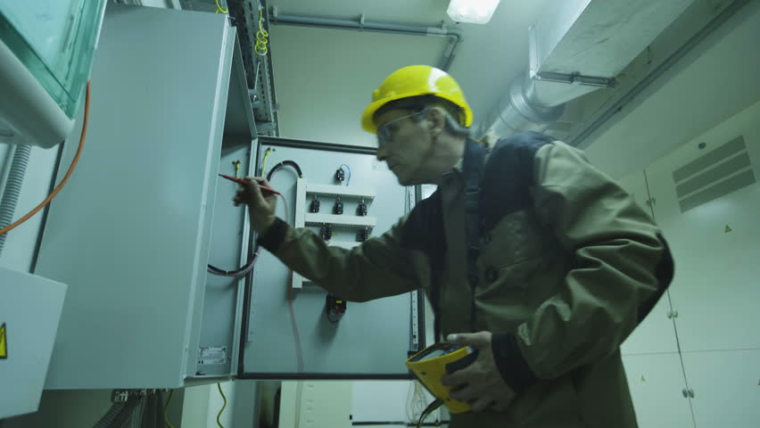 man doing electrical metering equipment