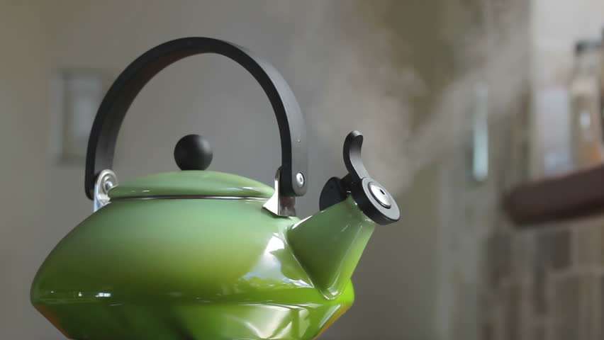 Boiling retro lime green kettle boiling with steam emitted from spout. Loop-able. Shallow DOF. Includes high quality whistling and boiling audio. #2037902