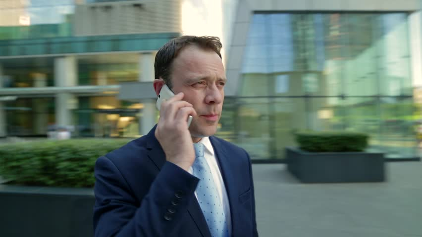 Businessman talking on the phone. Camera moves around the man, timelapse. Steadicam shot. | Shutterstock HD Video #20394832