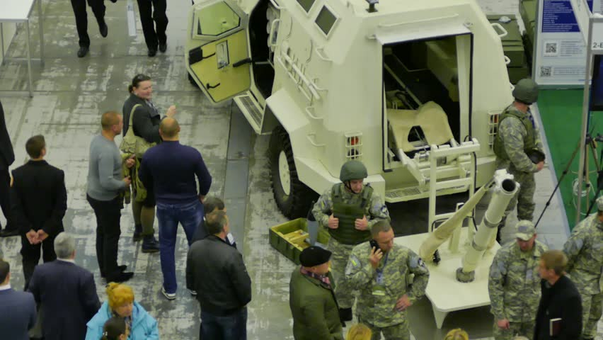 Kiev, Ukraine, 11 October, 2016: visitors are considering military equipment at the International Exhibition of Arms and Security 2016 in Kiev | Shutterstock HD Video #20401138