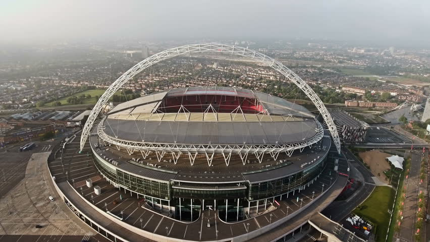 LONDON, UK - OCT 10 : Wembley Stadium on October 10, 2016 in London, England. Aerial View of Wembley Stadium, Soccer Arena Flying By Drone Shot in London 4K UHD Footage