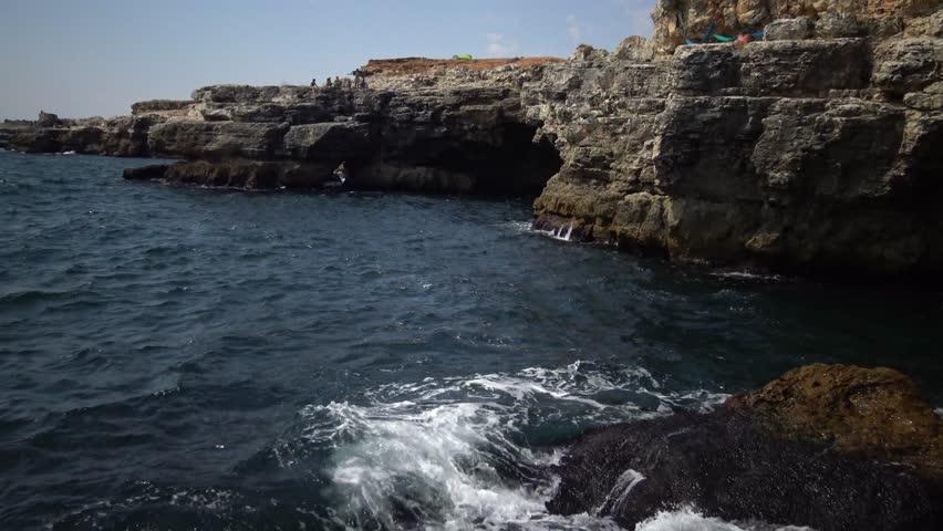 Beautiful rocky coast. Blue sea during a storm. | Shutterstock HD Video #20423128