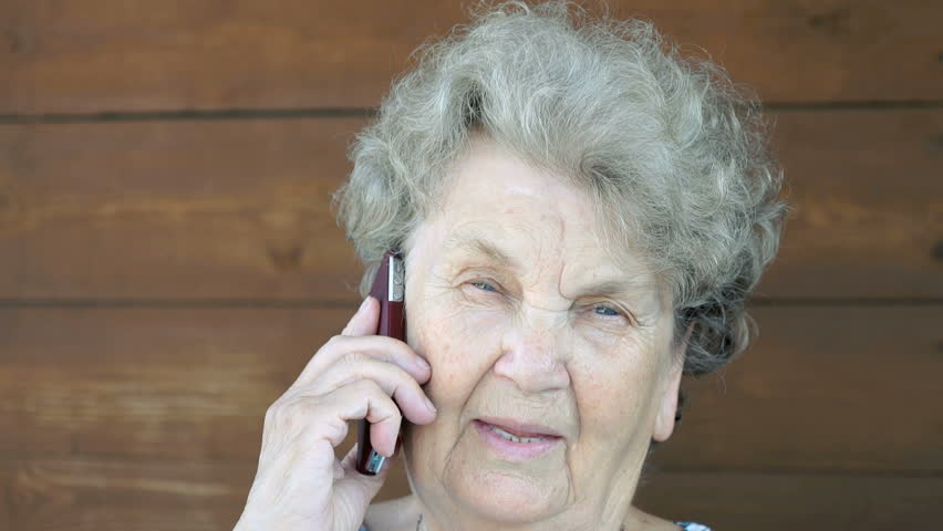 Elderly woman talking on the cell phone | Shutterstock HD Video #20429533