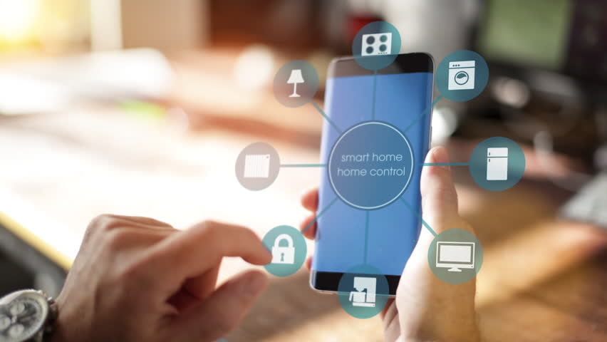 Smart Home - Man using smart home app on a smart phone. Smart home, intelligent house automation remote control concept. The Internet of things | Shutterstock HD Video #20433664