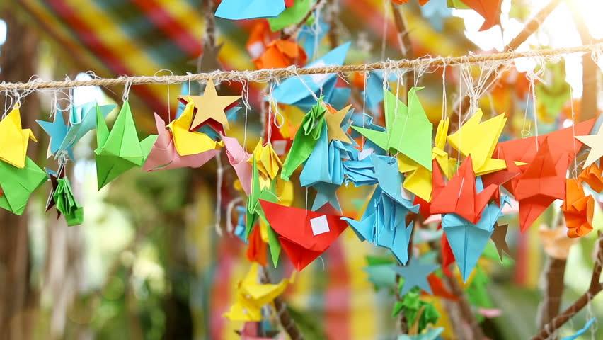 Origami paper bird spinning in wind, handmade, Japanese art of paper.  | Shutterstock HD Video #20438947