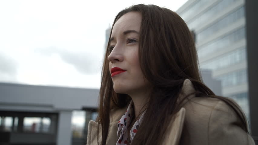 Beautiful girl standing on the street | Shutterstock HD Video #20445577