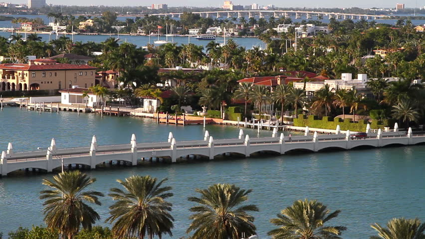 sailboats in miami bay area on a beautiful summer day, aerial view, near star island mansions