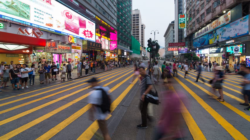 Time lapse of pedestrians and traffic at a busy road crossing, Nathan Road, Kowloon, Hong Kong, China (Jul 2016, Hong Kong) | Shutterstock HD Video #20465653