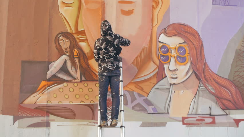 Graffiti artist painting on the wall | Shutterstock HD Video #20470816