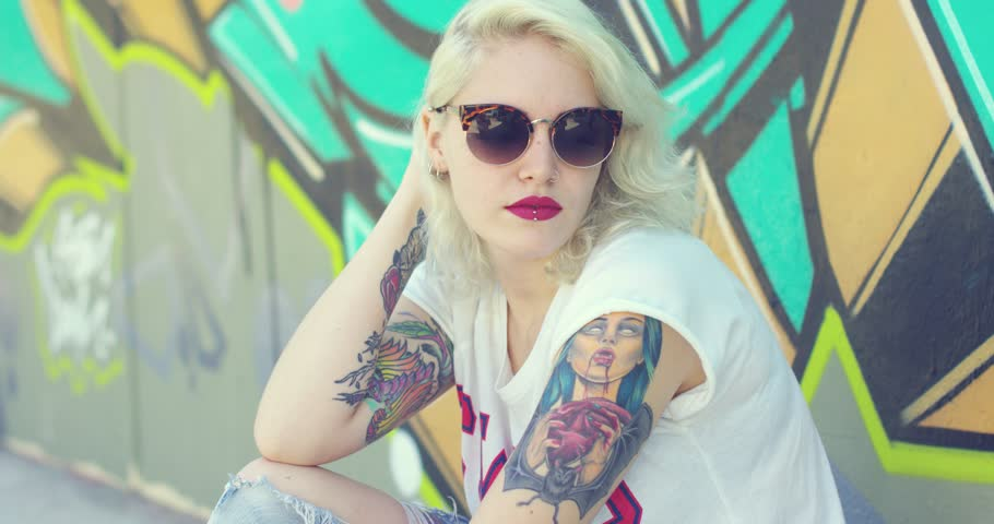 Trendy young woman with a vampire tattoo | Shutterstock HD Video #20478049