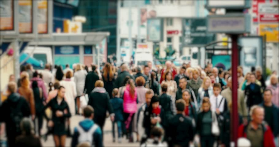 Crowd of People / Commuters Walking / Busy Street. Crowd on a busy street. People walk down a busy street with advertising, billboards, cars and public transport. Slow motion. (av18263c) | Shutterstock HD Video #20501362