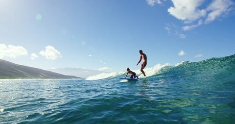 Father and son having fun surfing together
