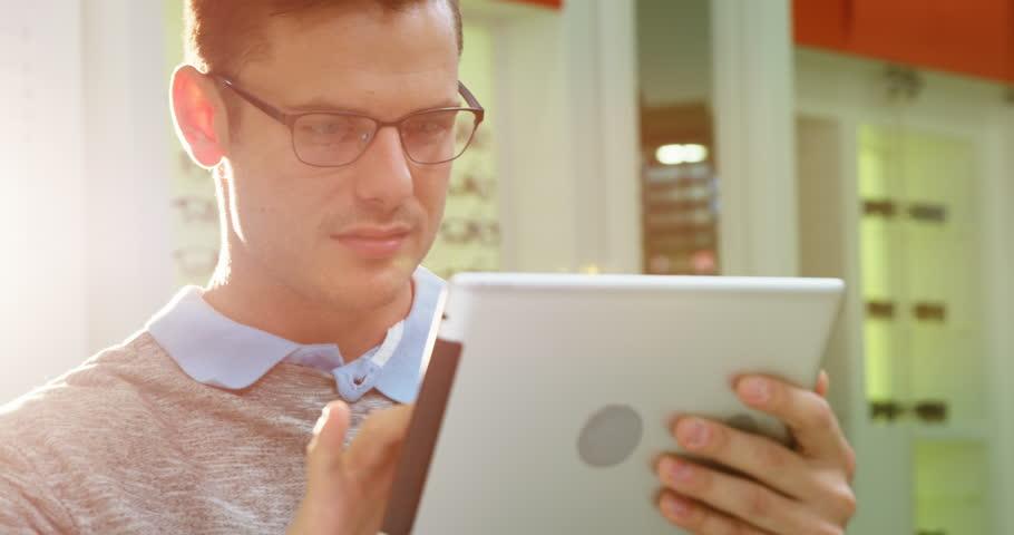 Attentive customer using digital tablet in optical store 4k | Shutterstock HD Video #20509978