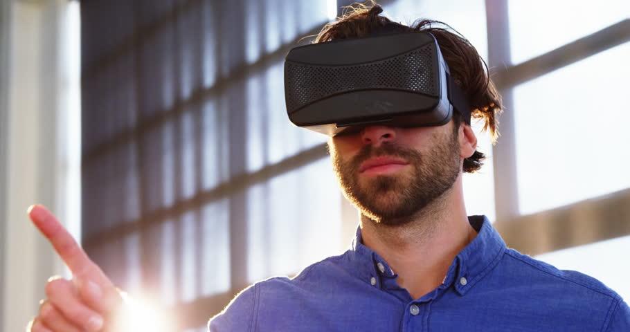 Man using virtual reality headset at office 4k