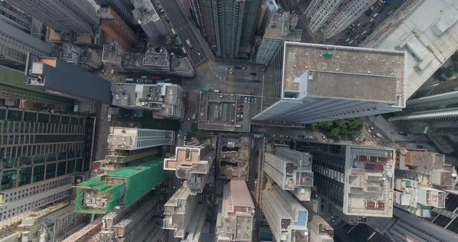 A bird's eye view of downtown Hong Kong in september. Top view of the city center.Beautiful aerial shot of many high skyscrapers.