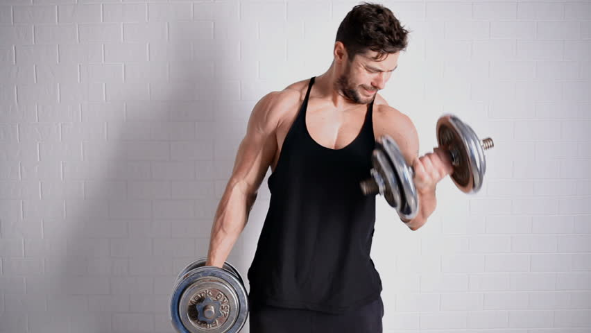 Strong topless man doing exercise with dumbbells   Shutterstock HD Video #20531161