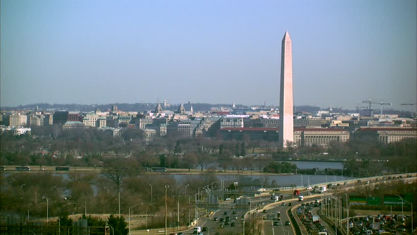 Airplane flies past the Washington Monument