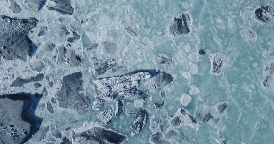 Aerial view of a glacier huge pieces of frozen ice and rock, top view