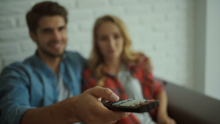Two young people relaxing at home with TV. | Shutterstock HD Video #20545828